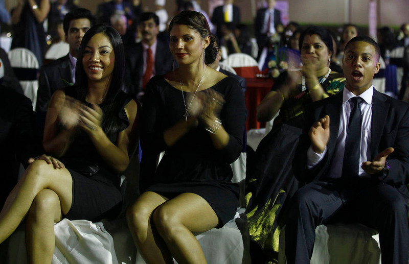 . U.S. citizens react as they watch the live TV telecast of the swearing-in ceremony for U.S President Barack Obama, as they sit inside the U.S. consulate in Mumbai, India, Monday, Jan. 21, 2013. (AP Photo/Rafiq Maqbool)