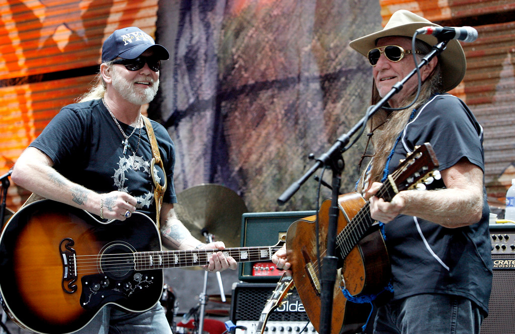 . Gregg Allman, left, and Willie Nelson perform together at Farm Aid on Randall\'s Island Sunday, Sept. 9, 2007 in New York.  (AP Photo/Jason DeCrow)