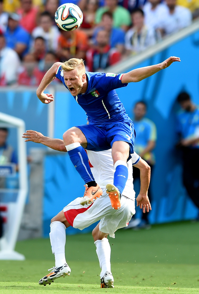 . Ignazio Abate of Italy goes up for a header against Christian Bolanos of Costa Rica during the 2014 FIFA World Cup Brazil Group D match between Italy and Costa Rica at Arena Pernambuco on June 20, 2014 in Recife, Brazil.  (Photo by Claudio Villa/Getty Images)