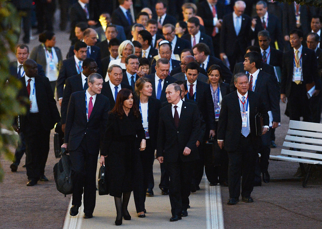 . In this handout image provided by Host Photo Agency, Russian President Vladimir Putin walks with G20 Summit members after the first day of the G20 Vladimir Astapkovichon September 5, 2013 in St. Petersburg, Russia.   (Photo by Igor Russak/Host Photo Agency via Getty Images)