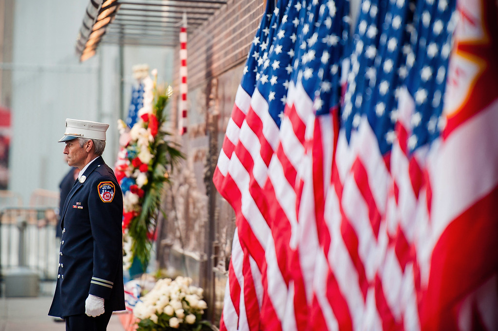 . A firefighter stands near the entrance to the 9/11 Memorial during the 12th anniversary of the 9/11 terror attacks, Wednesday, Sept. 11, 2013 in New York.  (AP Photo/Lauren Casselberry)