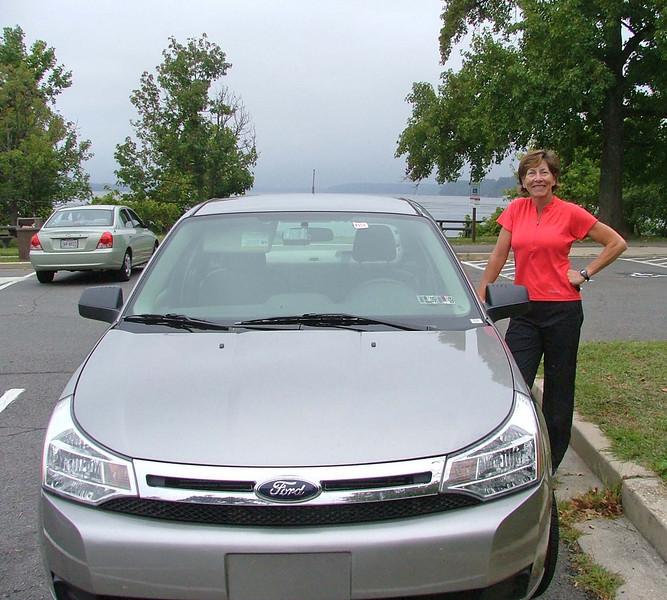 Jeri with rental car on the Potomac, near trail to Mount Vernon
