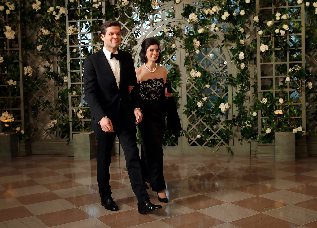 . Aaron Wess Mitchell and Elizabeth Mitchell arrive for a State Dinner with French President Emmanuel Macron and President Donald Trump at the White House, Tuesday, April 24, 2018, in Washington. (AP Photo/Alex Brandon)