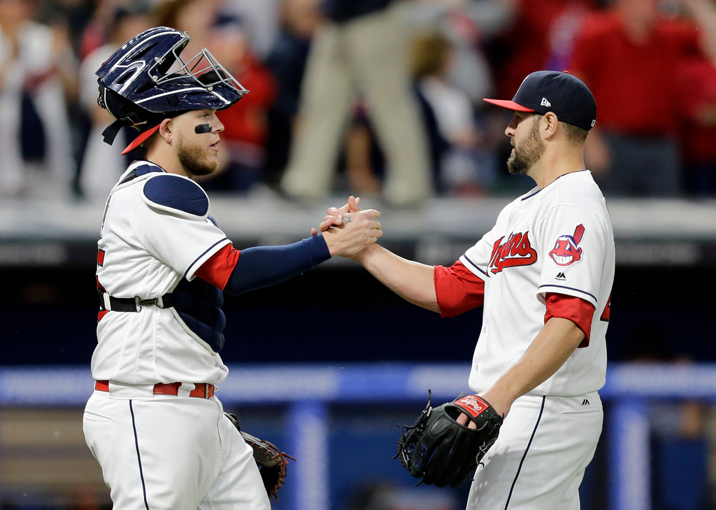 . Cleveland Indians relief pitcher Nick Goody, right, is congratulated by catcher Roberto Perez after the Indians defeated the Oakland Athletics 9-4 in a baseball game, Tuesday, May 30, 2017, in Cleveland. (AP Photo/Tony Dejak)