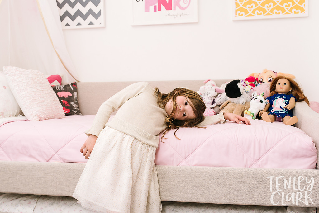 Little girl in her pink room. Lifestyle in-home family photoshoot in Marin, CA by Tenley Clark Photography.