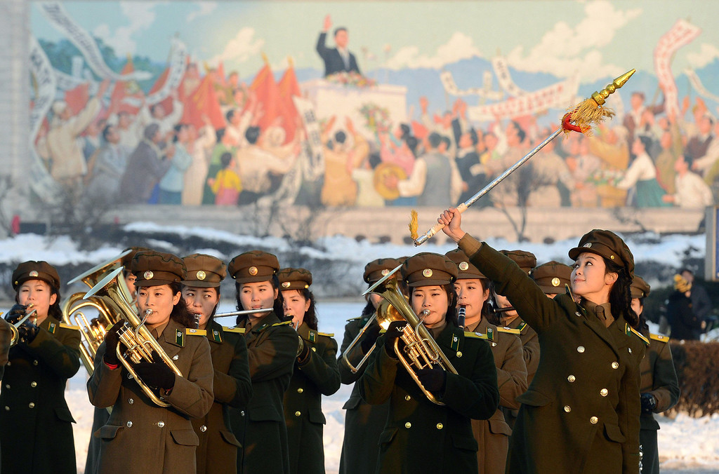 . Female members of a North Korean military band perform in celebration of the country\'s rocket launch in Pyongyang, North Korea Wednesday, Dec. 12, 2012. North Korea successfully fired a long-range rocket on Wednesday, defying international warnings as the regime of Kim Jong Un took a big step forward in its quest to develop a nuclear missile. (AP Photo/Kyodo News)