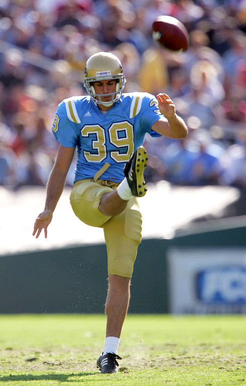 . UCLA Punter Chris Kluwe kicks the ball against the Stanford University Cardinal during a game at the Rose Bowl on October 30, 2004 in Pasadena, California. The Bruins won 21-0.  (Photo by Harry How/Getty Images)
