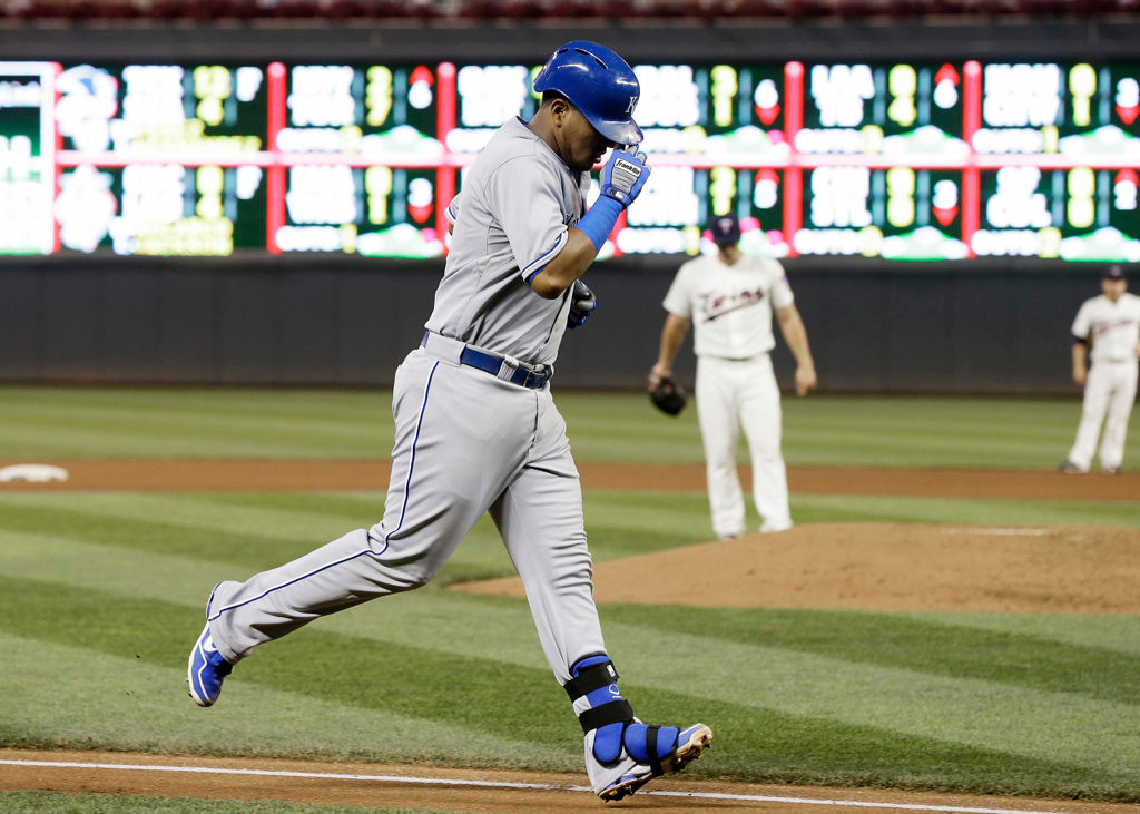 . Kansas City Royals\' Salvador Perez trots home with a two-run home run off Minnesota Twins pitcher Andrew Albers, center background, in the fourth inning of a baseball game. (AP Photo/Jim Mone)