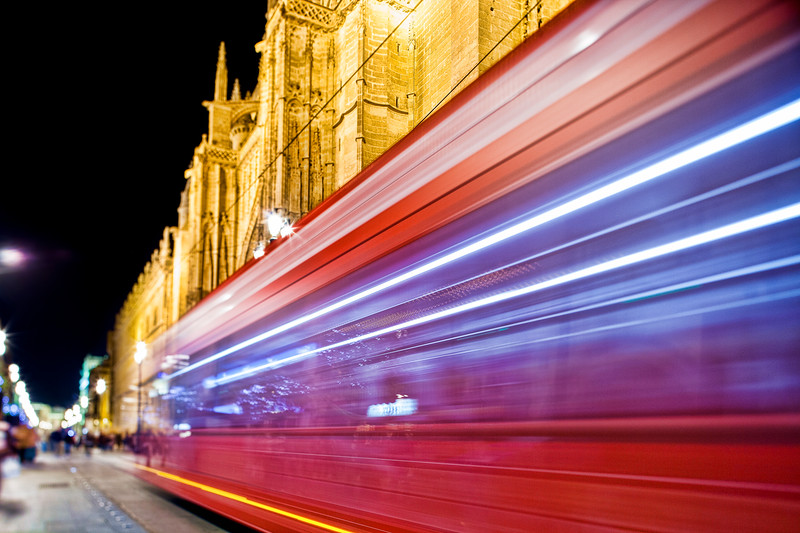 Streetcar passing by in front of Seville's Cathedral, Spain.