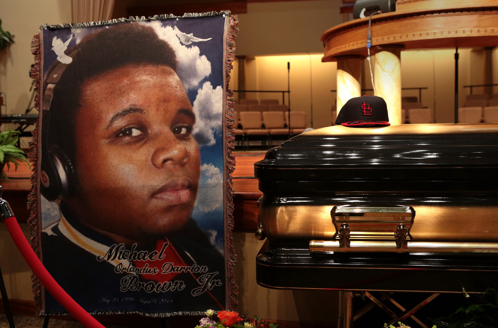 Description of . The casket of Michael Brown sits inside Friendly Temple Missionary Baptist Church awaiting the start of his funeral on August 25, 2014 in St. Louis Missouri. Michael Brown,18 year-old unarmed teenager, was shot and killed by a  Ferguson Police Officer Darren Wilson in the nearby town of Ferguson, Missouri on August 9. His death caused several days of violent protests along with rioting and looting in Ferguson.  (Photo by Robert Cohen-Pool/Getty Images)
