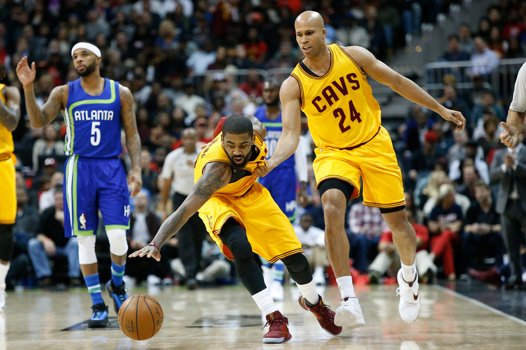 . Cleveland Cavaliers guard Kyrie Irving (2) and forward Richard Jefferson (24) reach for a ball against the Atlanta Hawks in the second half of an NBA basketball game, Friday, March 3, 2017, in Atlanta. The Cavaliers won 135-130. (AP Photo/Brett Davis)