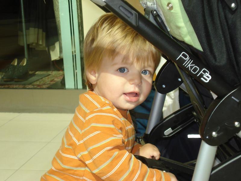 Elliot pushing his stroller