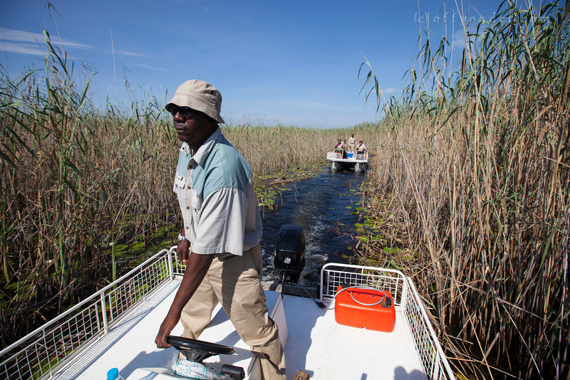 BWABWATA NP, NAMIBIA - Motoring through the narrow backwaters of the Kwandu River.