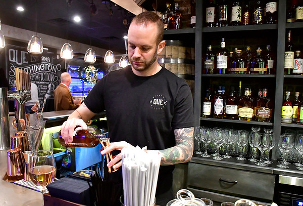 12/1/2018 Mike Orazzi | Staff Bartender Brandon Martin mixes a drink during a sneak-peek event Saturday to help raise funds for the Southington High School All Knight Grad Party at the Que Whiskey Kitchen on Queen Street.