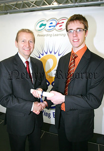 Stephen Begley a past pupil of Abbey Christian Brothers Grammar School, Newry accepts a certificate from CCEA's Chairman, Alan Lennon to mark his fantastic achievement of overall first place in Biology in CCEA's summer 2006 A level examinations.