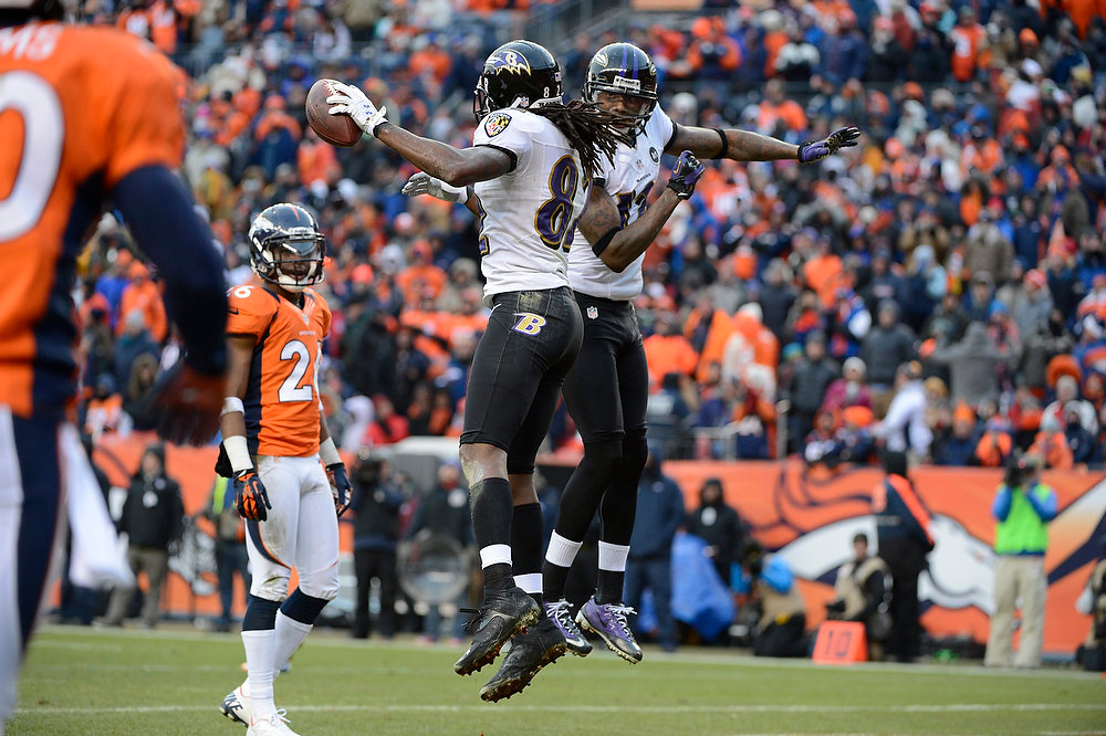 Description of . Baltimore Ravens wide receiver Torrey Smith (82) celebrates with Baltimore Ravens wide receiver Jacoby Jones (12) after scoring a touchdown against Denver Broncos cornerback Champ Bailey (24) during the second quarter.  The Denver Broncos vs Baltimore Ravens AFC Divisional playoff game at Sports Authority Field Saturday January 12, 2013. (Photo by Hyoung Chang,/The Denver Post)