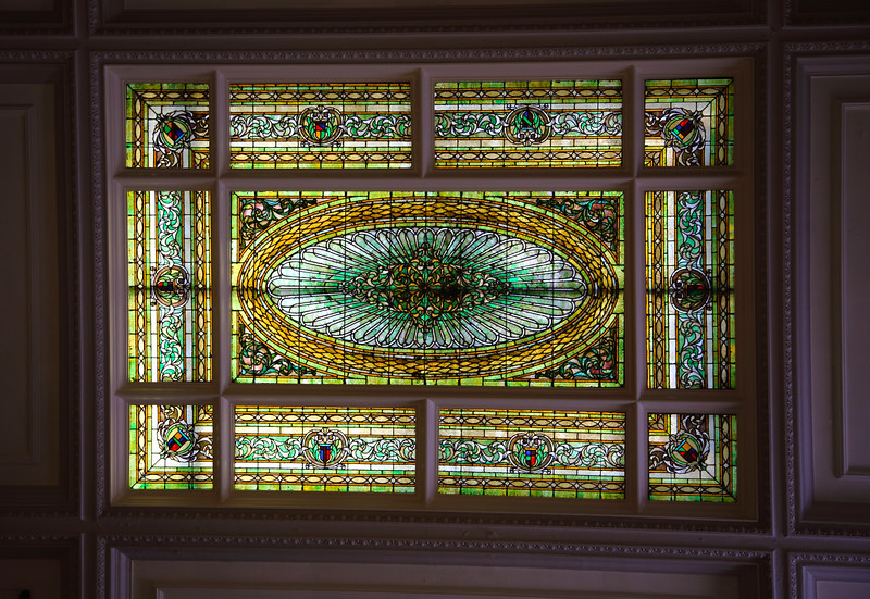 Stained glass in the ceiling of a historic lobby