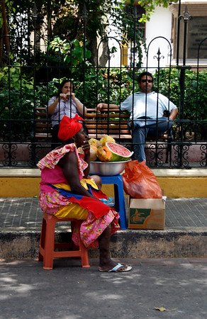 A fruit seller in Plaza de Bolivar, Cartagena, Colombia