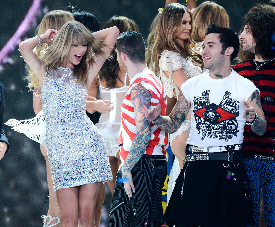 . Singer Taylor Swift, left, and musician Pete Wentz, right, celebrate during the finale of the 2013 Victoria\'s Secret Fashion Show at the 69th Regiment Armory on Wednesday, Nov. 13, 2013, in New York. (Photo by Evan Agostini/Invision/AP)