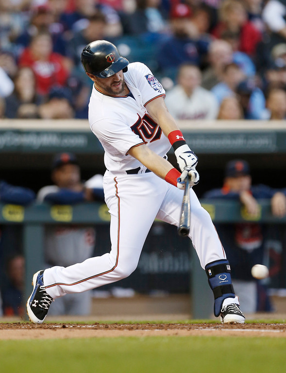 . Minnesota Twins� Trevor Plouffe hits an RBI single off Detroit Tigers pitcher David Price in the first inning of a baseball game, Monday, April 27, 2015, in Minneapolis. (AP Photo/Jim Mone)