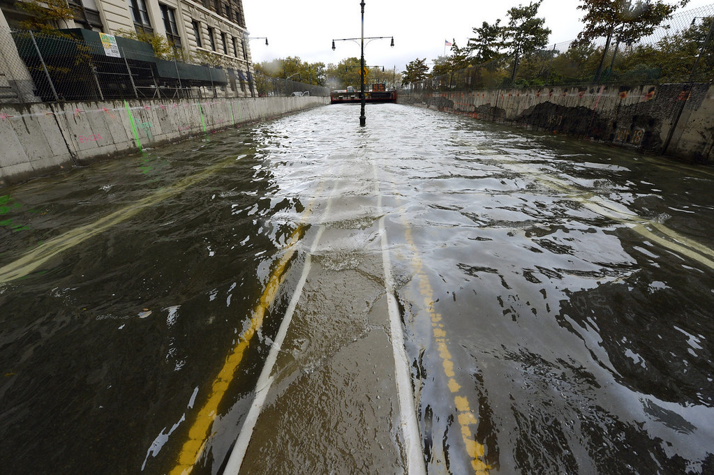 . A flooded Brooklyn Battery park Tunnel on October 30, 2012. The death toll from superstorm Sandy has risen to 16 in the mainland United States and Canada, and was expected to climb further as several people were still missing, officials said Tuesday.  Connecticut, New York, New Jersey, Maryland, Pennsylvania, West Virginia and North Carolina reported 15 dead from the massive storm system, and Toronto police said a Canadian woman was killed by flying debris.   AFP PHOTO / TIMOTHY A. CLARY