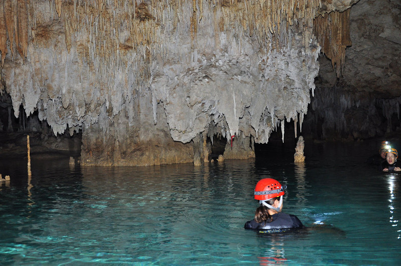 . Floating in the cool underground waters of Rio Secreto near Playa del Carmen, Mexico, beneath the dramatic stalactites.  (Provided by Rio Secreto)