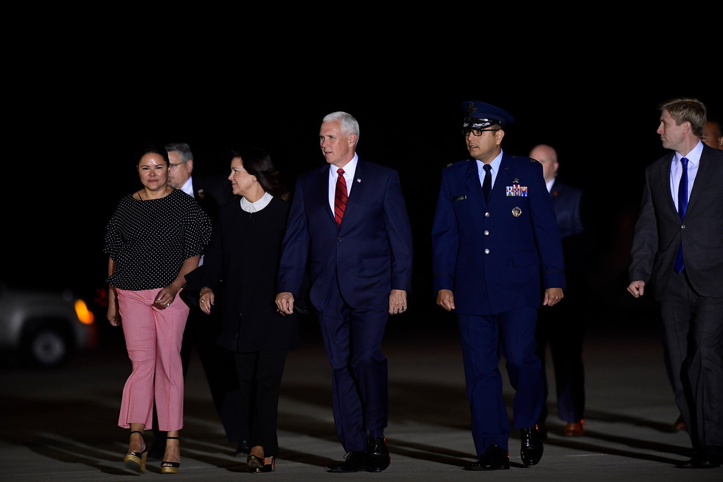 . Vice President Mike Pence, center, and his wife Karen, center left, arrive at Andrews Air Force Base in Md., to greet the three Americans detained in North Korea for more than a year, Thursday, May 10, 2018. (AP Photo/Susan Walsh)
