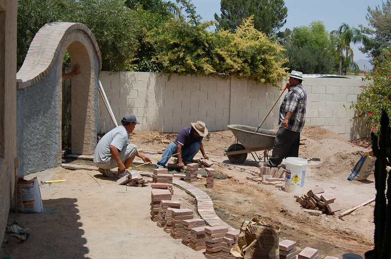 And now we're building the curved brick pathway. The next several shots are of the progress being made on that walk.
