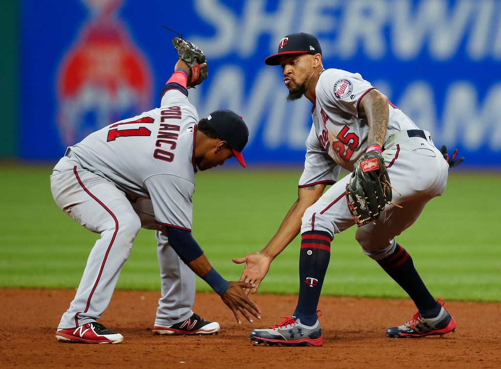 . Minnesota Twins\' Jorge Polanco (11) and Byron Buxton (25) celebrate an 8-6 victory over the Cleveland Indians in a baseball game, Tuesday, Sept. 26, 2017, in Cleveland. (AP Photo/Ron Schwane)