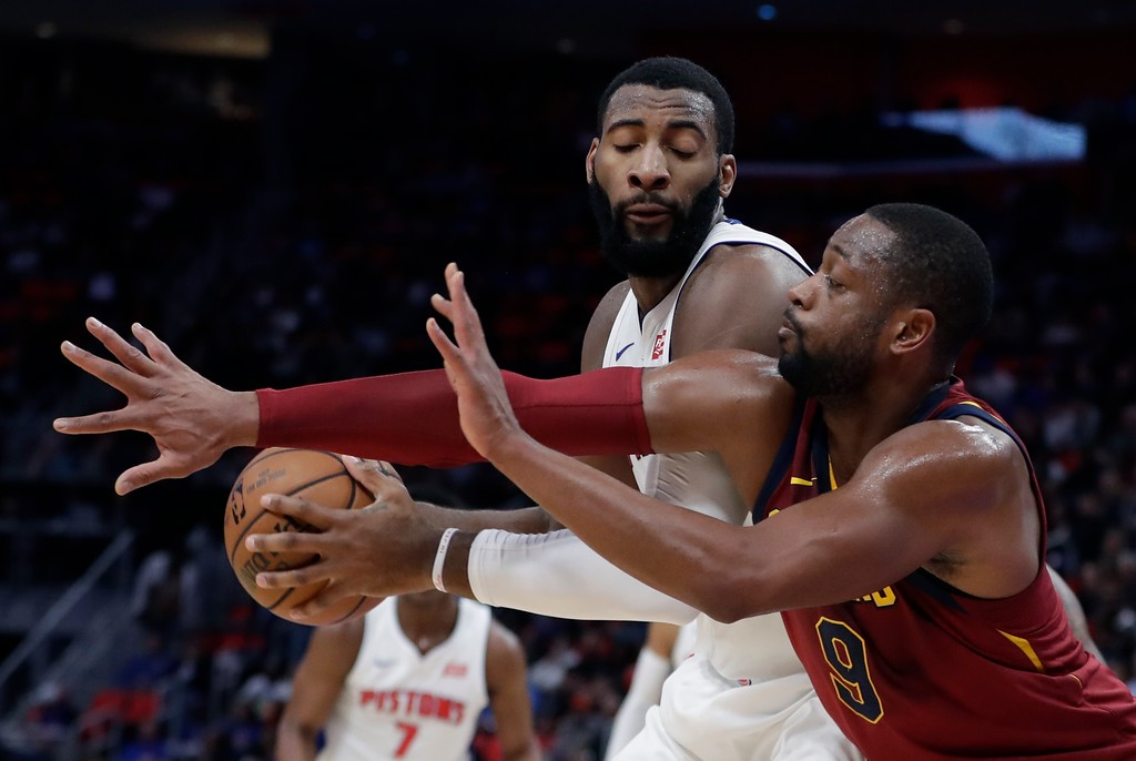 . Cleveland Cavaliers guard Dwyane Wade, right, reaches as Detroit Pistons center Andre Drummond controls the ball during the first half of an NBA basketball game, Monday, Nov. 20, 2017, in Detroit. (AP Photo/Carlos Osorio)