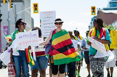 KITCHENER, Ont. (23/07/2016) - Members of the Zimbabwe Canada Association of Waterloo, gather together at Victoria Park for a peaceful march to draw attention to government and human rights violations in Zimbabwe. There has been a civic unrest across the country without response from the government. #thisflag is the hash tag created by Pastor Evan Mawarire to begin a boycott earlier this month to bring awareness to what in happening in Zimbabwe.  Rev. James Kandoje, President of the association led the march from Victoria Park to Kitchener City Hall via Jacob, Queen, and King St.  Photos by Alicia Wynter/The Record
