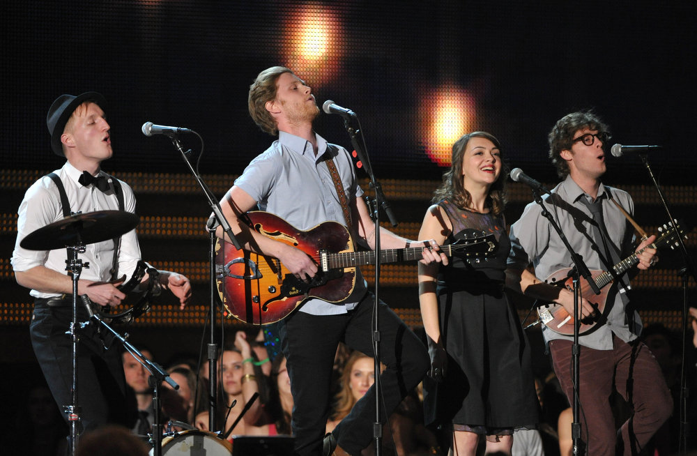 Description of . The Lumineers, from left, Jeremiah Fraites, Wesley Schultz, Neyla Pekarek and Stelth Ulvang perform at the 55th annual Grammy Awards on Sunday, Feb. 10, 2013, in Los Angeles. (Photo by John Shearer/Invision/AP)
