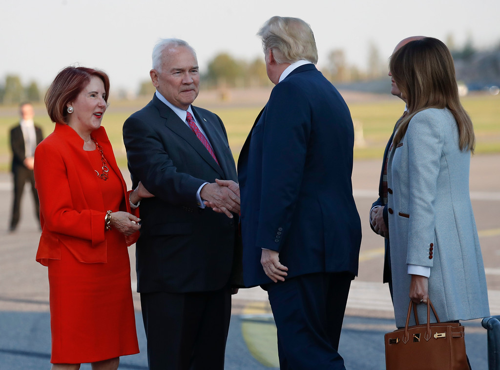 . U.S. President Donald Trump and first lady Melania Trump are greeted by Frank Pence, second from the left, U.S. Ambassador to Finland and his wife Suzy Pence, far left, on the tarmac upon their arrival at the airport in Helsinki, Finland, Sunday, July 15, 2018. (AP Photo/Pablo Martinez Monsivais)