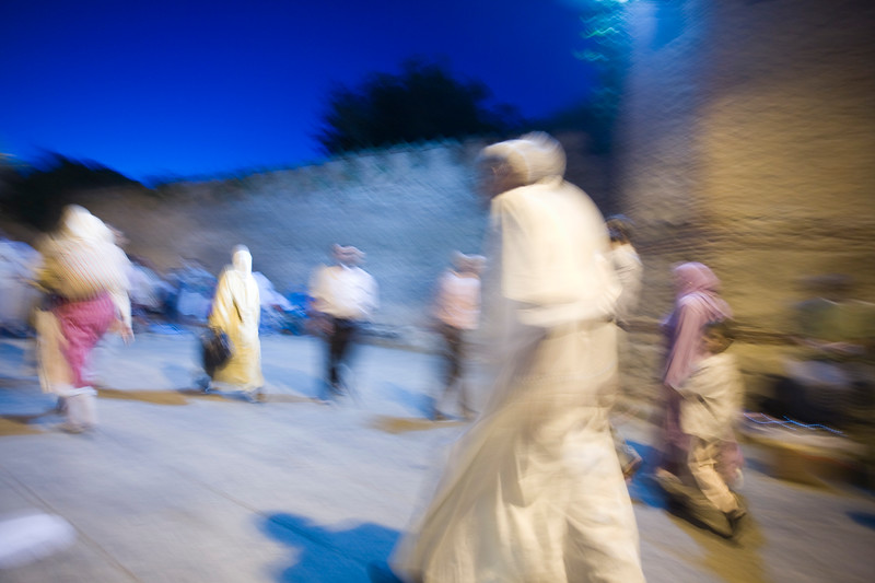 People walking at dusk by the city wall, Tetouan, Morocco