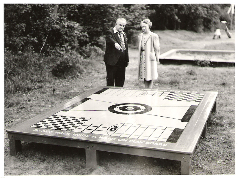 Mayor Biertuempfel and Ester eggbert marvel at his gameboard.