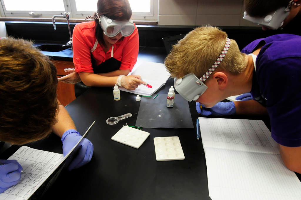 . Coon Rapids High School juniors, from left, Nick Roloff, Tracey Hook and Garrett Dey examine the characteristics of unknown powders during their Principles of the Biomedical Sciences class at the high school Wednesday, Sept. 11, 2013, in Coon Rapids. (Pioneer Press: Scott Takushi)