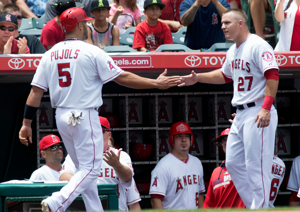 . Angels\' Mike Trout (#27) congratulates Albert Pujols (#5) after scoring against the Minnesota Twins at Angel Stadium in Anaheim on Thursday June 26, 2014. The Angels defeated the Minnesota Twins 6-4. (Photo by Keith Durflinger/Whittier Daily News)