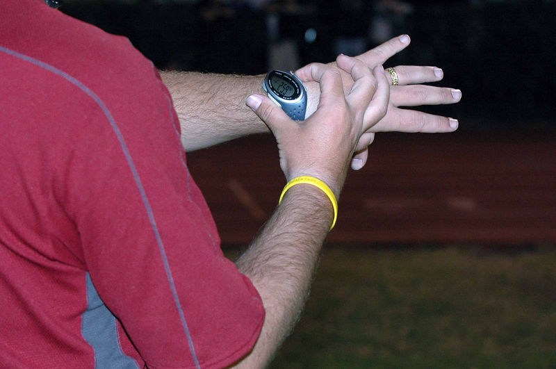 """A few words of explanation here. After the PV action, I move over to snap shots of the Girls' 3200m. Of course I'm late, and have more camera fiddling, as well. I ask Oak Hall Coach Edwin McTureous for a time check. This shot was taken as Edwin's watch was at 2:59. He called 3:00, so we'll go with that to """"split"""" the remaining Girls' 3200m photos. Exif time is 18:52, let's say the race began at 15:52 and do the remaining math."""
