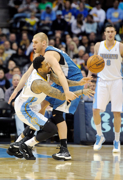 . Denver Nuggets guard Wilson Chandler, left, steals the ball from Minnesota Timberwolves center Greg Stiemsma, right, in the second half of an NBA basketball game on Saturday, March 9, 2013, in Denver. (AP Photo/Chris Schneider)