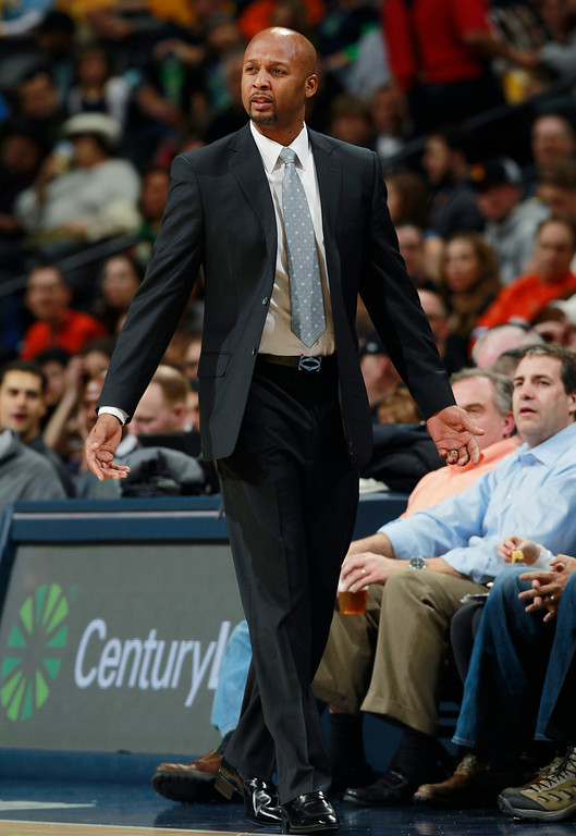 . Denver Nuggets head coach Brian Shaw argues a call against his team while facing the Toronto Raptors in the first quarter of an NBA basketball game in Denver, Friday, Jan. 31, 2014. (AP Photo/David Zalubowski)