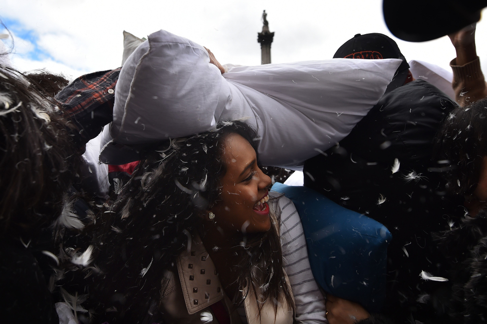 Description of . Revelers take part in a mass pillow fight in Trafalgar Square in central London on April 5, 2014 on International Pillow Fight Day. (BEN STANSALL/AFP/Getty Images)