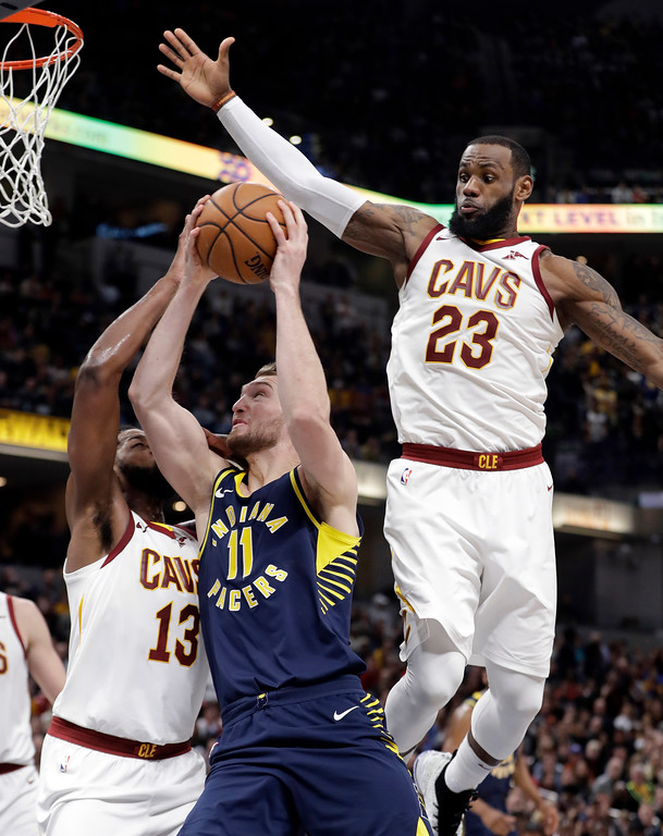 . Indiana Pacers\' Domantas Sabonis (11) shoots against Cleveland Cavaliers\' Tristan Thompson (13) and LeBron James (23) during the second half of an NBA basketball game, Friday, Jan. 12, 2018, in Indianapolis. (AP Photo/Darron Cummings)