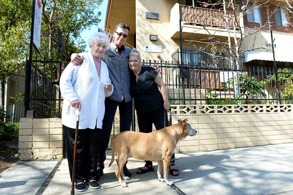 . From left, apartment owner Judy Guth, apartment manager Jerry Schiess and Mary Ricketts, with her dog Sadie at Guth\'s North Hollywood apartment that requires tenants to have pets, Wednesday, February 19, 2014. (Photo by Michael Owen Baker/L.A. Daily News)