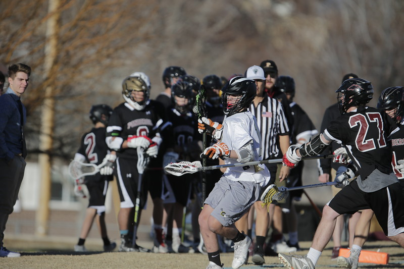 JPM0052-JPM0052-Jonathan first HS lacrosse game March 9th.jpg