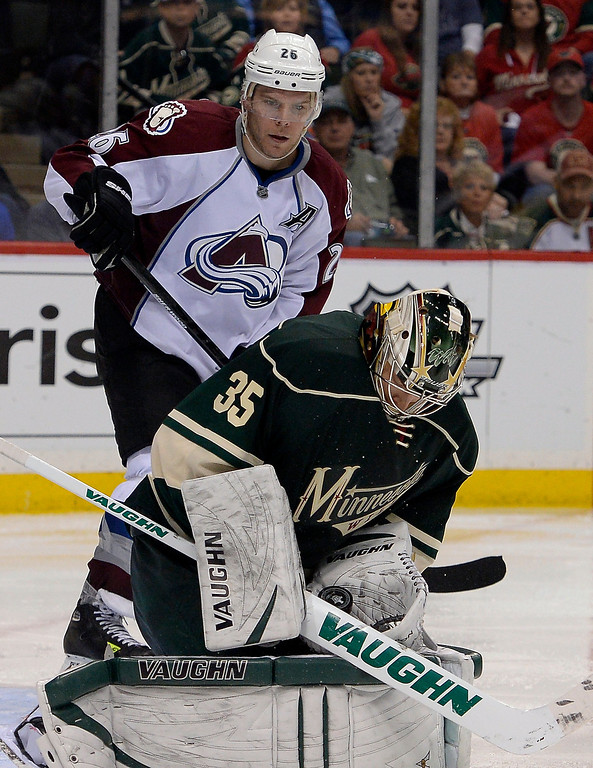 . Minnesota Wild goalie Darcy Kuemper (35) makes a save on a shot as Colorado Avalanche center Paul Stastny (26) looks on during the overtime April 21, 2014 during round 1 game three of the Stanley Cup Playoffs at Xcel Energy Center. The Minnesota Wild defeated the Colorado Avalanche 1-0 to take game 3. (Photo by John Leyba/The Denver Post)