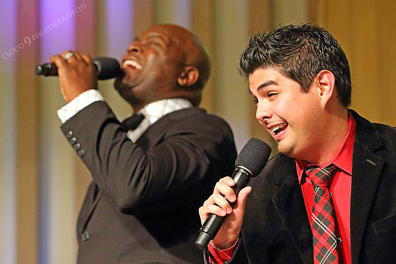 AMER-CMM 00004 Heritage Singers Tim Calhoun and Miguel Verazas sing together before a church audience by Peter J Mancus.JPG