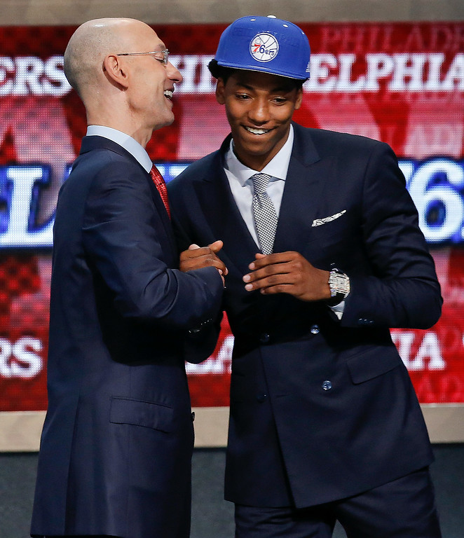 . Elfrid Payton, right, is greeted by NBA Commissioner Adam Silver after being selected as the 10th overall pick by the Philadelphia 76ers during the 2014 NBA draft, Thursday, June 26, 2014, in New York. He was then traded to the Orlando Magic. (AP Photo/Kathy Willens)
