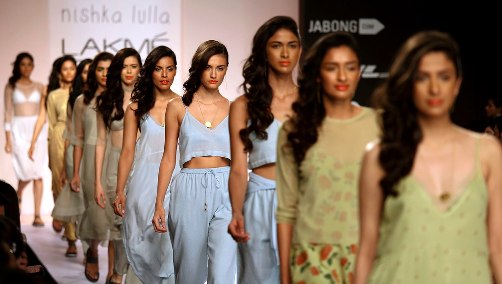 . Models present creations by Indian designer Nishka Lulla during an opening show of the Lakme Fashion Week Summer/Resort 2014 in Mumbai, India, 12 March 2014. Some 92 designers will be showcasing their collections at the event running from 12 to 16 March.  EPA/DIVYAKANT SOLANKI