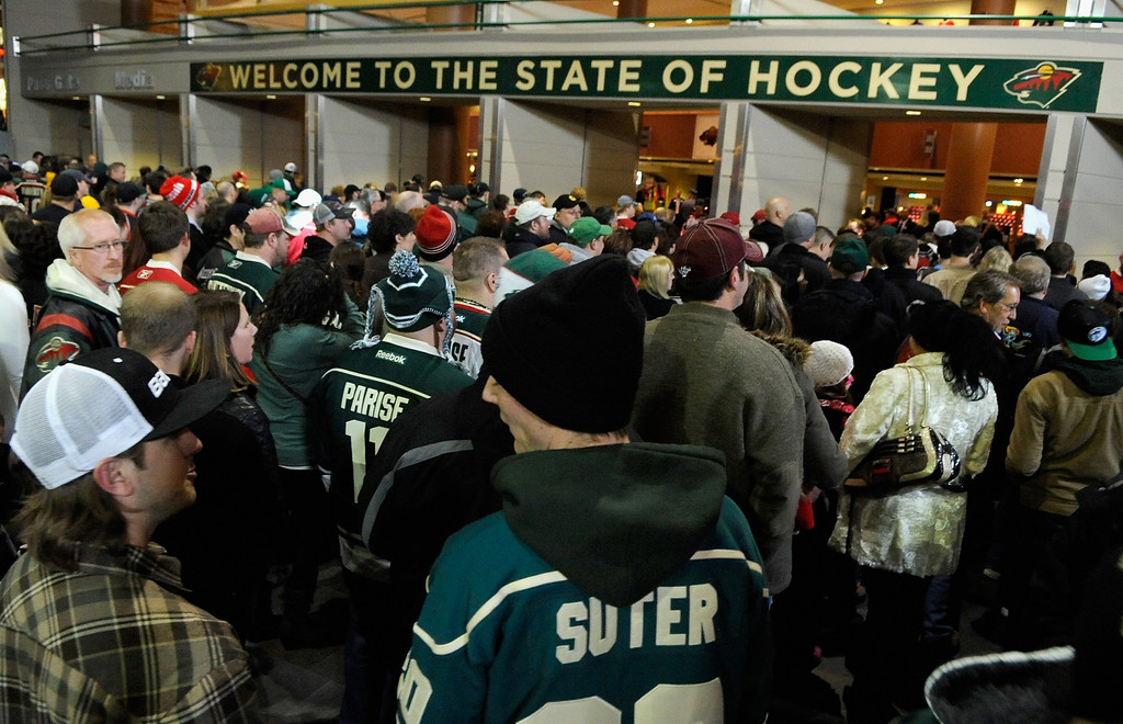 . ST. PAUL, MN - JANUARY 19:  Fans wait for the gates to open for the season opener between the Minnesota Wild and the Colorado Avalanche on January 19, 2013 at Xcel Energy Center in St. Paul, Minnesota.  (Photo by Hannah Foslien/Getty Images)