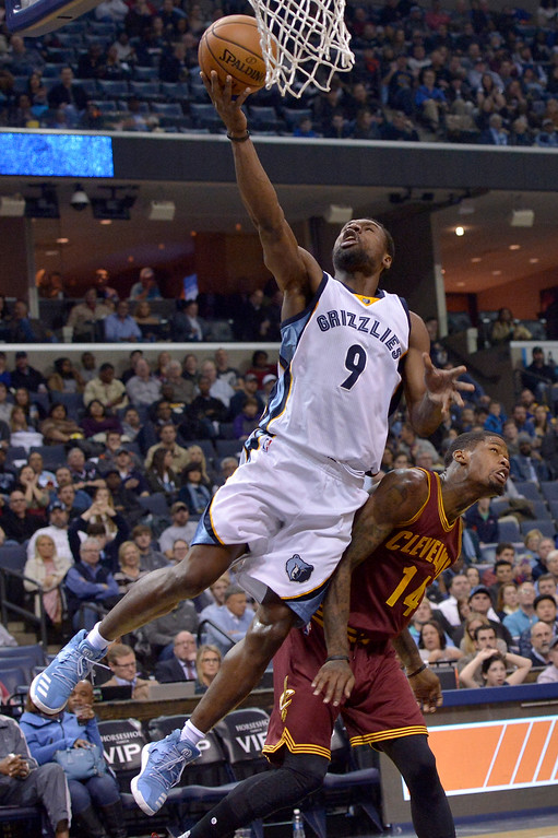 . Memphis Grizzlies guard Tony Allen (9) is fouled by Cleveland Cavaliers guard DeAndre Liggins (14) as he shoots in the second half of an NBA basketball game Wednesday, Dec. 14, 2016, in Memphis, Tenn. (AP Photo/Brandon Dill)